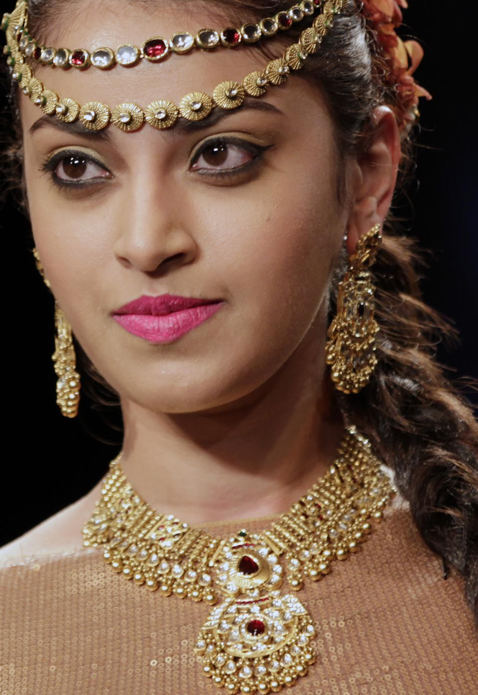 An Indian model displays a creation by Neeta Lulla during the Lakme Fashion Week in Mumbai, India, Tuesday, Aug. 7, 2012. (AP Photo/Rajanish Kakade)