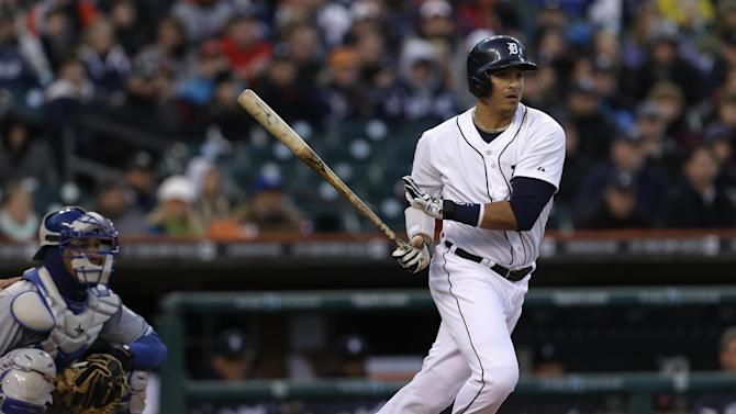 Detroit Tigers' Victor Martinez, right, hits a one-run double against the Kansas City Royals in the third inning of a baseball game in Detroit, Wednesday, April 24, 2013. (AP Photo/Paul Sancya)