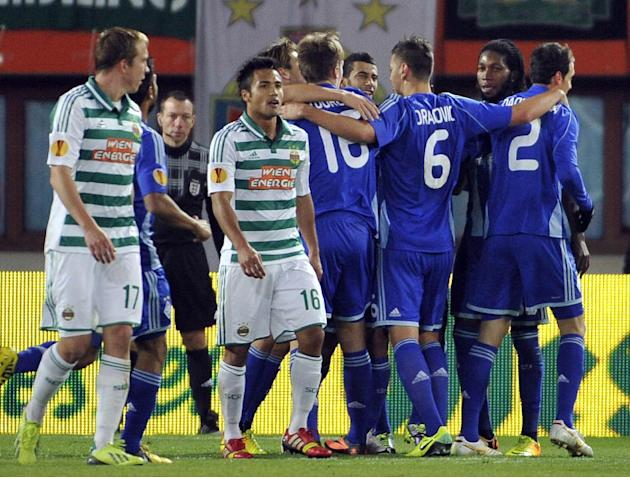 Kiev's players, right, celebrate after scoring next to Rapid's Christopher Dibon and Stephan Palla, from left, during their Europa League second round group G soccer match between SK Rapid Wien and FC