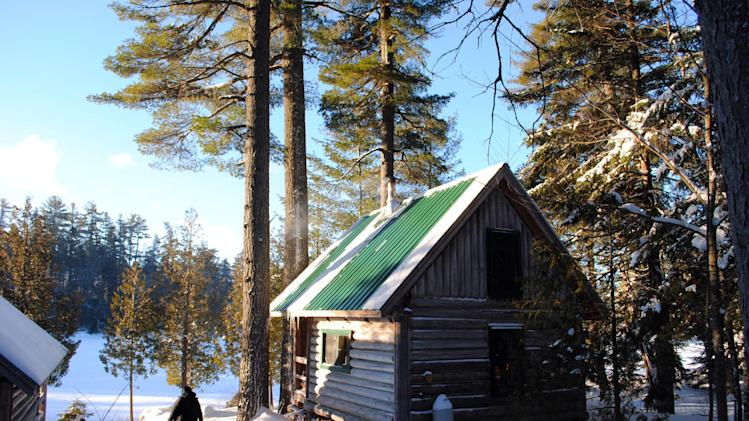 This December 2012 photo shows a rustic cabin in the snow at the Appalachian Mountain Club's Gorman Chairback Lodge, a backcountry wilderness lodge near Greenville, Maine. In winter, visitors can reach the lodges and cabins only by cross-country skiing in.  (AP Photo/Lynn Dombek)