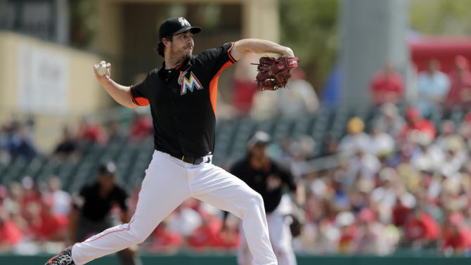 Miami Marlins starting pitcher Dan Haren throws during the first inning of an exhibition spring training baseball game against the St. Louis Cardinals Thursday, March 5, 2015, in Jupiter, Fla. (AP Photo/Jeff Roberson)