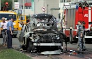 Russian forensic experts examine Ildus Faizov's car in Kazan. Faizov -- the Islamic leader of Russia's main Muslim region of Tatarstan -- was wounded in a car explosion while another cleric was killed in a rare attacks in an oil-rich republic often praised for its religious tolerance