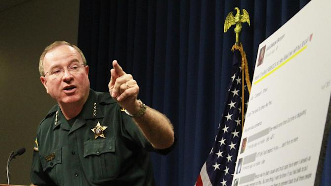 Polk County Sheriff Grady Judd talks about the events leading up to the arrest over the weekend of two juvenile girls in a Florida bullying case at a press conference in Winter Haven, Fla., Monday, Oct. 15, 2013. Two middle school girls ages 14 and 12 have been arrested and charged with felony aggravated stalking in connection with the suicide earlier this year of 12-year-old Rebecca Ann Sedwick in Lakeland. Judd said police arrested the 14-year-old girl after she posted online Saturday that she bullied Rebecca and she didn't care. The 12-year-old girl was Rebecca's former best friend, but Judd said the 14-year-old girl turned her against Rebecca. (AP Photo/The Ledger, Calvin Knight) TAMPA TRIBUNE OUT