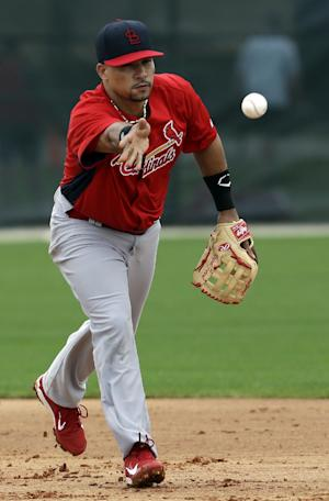 FILE - In this Feb. 15, 2013 file photo, St. Louis Cardinals shortstop Rafael Furcal tosses a ball to second base during the team's first full squad workout at spring training baseball in Jupiter, Fla. Furcal will have major surgery on his right elbow next week. The team did not say in its statement Thursday, March 7, 2013,  how long the three-time All-Star will be out. (AP Photo/Julio Cortez, File)