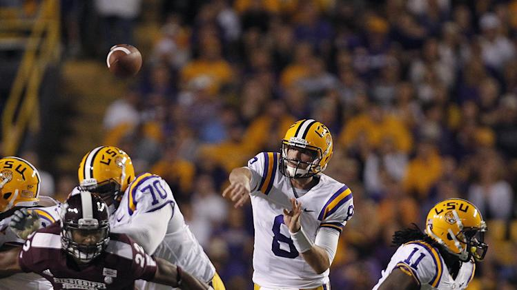 LSU quarterback Zach Mettenberger (8) passes in the first half of their NCAA college football game against Mississippi State in Baton Rouge, La., Saturday, Nov. 10, 2012. (AP Photo/Gerald Herbert)