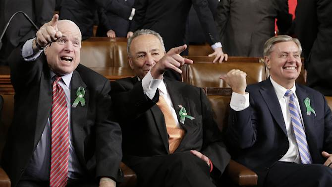 From left, Sen. John McCain, R-Ariz., Sen. Charles Schumer, D-N.Y. and Sen. Lindsey Graham, R-S.C. sit on Capitol Hill in Washington, Tuesday, Feb. 12, 2013, before President Barack Obama's State of the Union address during a joint session of Congress . (AP Photo/Charles Dharapak, Pool)