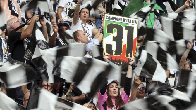 Juventus supporters celebrate during a Serie A soccer match between Juventus and Palermo, at the Juventus stadium, in Turin, Italy, Sunday, May 5, 2013. Juventus needs a point against Palermo to clinch a second successive league title. (AP Photo/Luca Bruno)