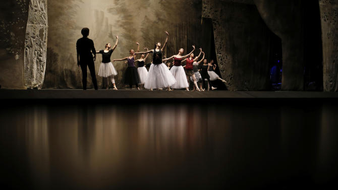 """In this photo made Tuesday, Feb. 5, 2013, Bolshoi dancers hold a rehearsal of the ballet Giselle in the Bolshoi Theater in Moscow, Russia. Pavel Dmitrichenko, a Russian ballet star who most recently played the title role in """"Ivan the Terrible"""" at the famed Bolshoi Theater has confessed that he organized the acid attack on the theater's ballet chief, Sergei Filin, Moscow police said Wednesday March 6, 2013.  (AP Photo/Alexander Zemlianichenko)"""