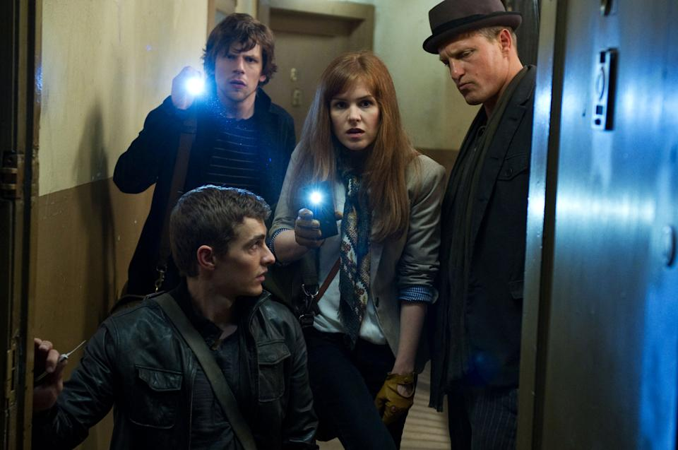 "This undated publicity photo released by Summit Entertainment, LLC shows, clockwise from bottom, Dave Franco, Jesse Eisenberg, Isla Fisher and Woody Harrelson, in a scene from the film, ""Now You See Me."" (AP Photo/Summit Entertainment, LLC, Barry Wetcher, SMPSP)"