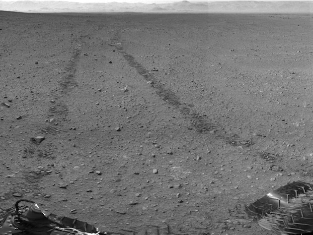 This handout photo provided by NASA/JPL-Caltech shows the surroundings of the location where NASA Mars rover Curiosity arrived on Sept. 4, 2012. It is a mosaic of images taken by Curiosity's Navigatio