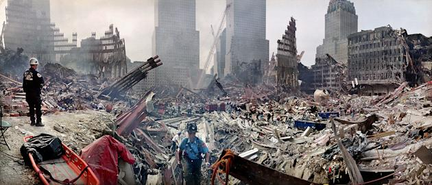 FILE - In this Monday, Sept. 24, 2001 file photo, rescue workers examine the site of the Sept. 11, 2001 World Trade Center terrorist attacks in New York. Several experts say there's no hard evidence t