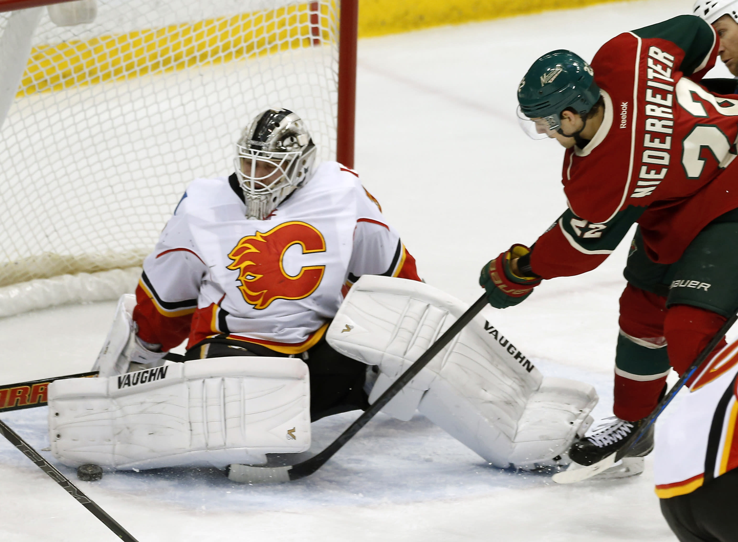 Vanek, Koivu, Parise score in third, Wilds beat Flames 4-2