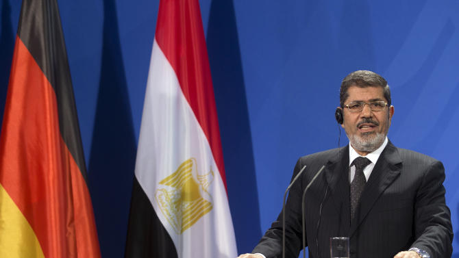 President of Egypt Mohammed Morsi, addresses the media during a joint press conference with German Chancellor Angela Merkel, unseen, after a meeting at the chancellery in Berlin, Germany, Wednesday, Jan. 30, 2013. (AP Photo/Michael Sohn)