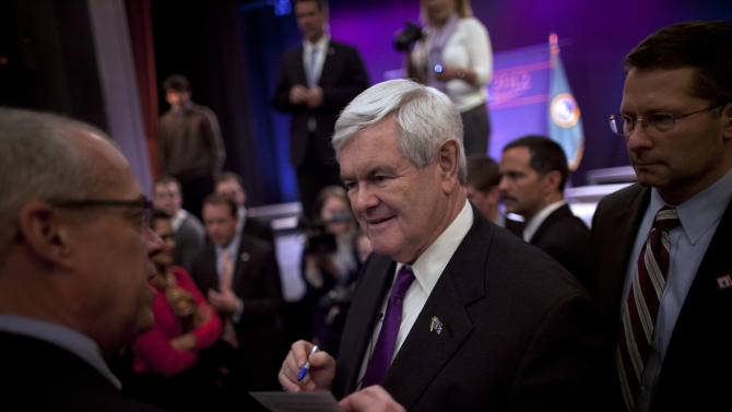 Republican presidential candidate, former House Speaker Newt Gingrich signs autographs during a campaign stop on Friday, Feb. 24, 2012 in Everett, Wash.  (AP Photo/Evan Vucci)