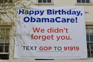 "<p>A banner marking the anniversary of ""ObamaCare"" is seen outside of the Republican National Committee office in March, 2012 in Washington, DC. The imminent US Supreme Court decision on Barack Obama's signature health care reforms has major implications for November's presidential election and for the future of the United States.</p>"