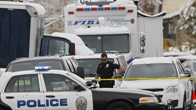 A Westminster Police Officer is surrounded by police vehicles at the home of Austin Reed Sigg, 17, where investigators  spent the second day gathering evidence in Westminster, Colo., on Thursday, Oct. 25, 2012.  Sigg is the suspect arrested in connection with the death of 10-year-old Jessica Ridgeway who disappeared Oct. 5 after leaving home for school. Her remains were found 5 days later. (AP Photo/Ed Andrieski)
