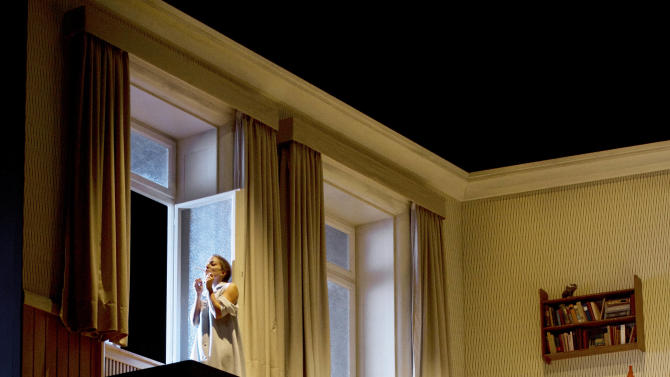 "In this Oct. 29, 2012 photo provided by the Opernhaus Frankfurt Christian Gerhaher in the role of Pelleas, bottom, and Christiane Karg as Melisande, top, perform during a dress rehearsal for the Claude Debussy's opera ""Pelleas et Melisande"" at the opera in Frankfurt, central Germany. (AP Photo/Opernhaus Frankfurt, Monika Rittershaus) NO SALES - ONE TIME USE ONLY NO ARCHIVE"