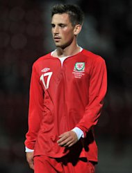Wales under-21 striker Elliott Chamberlain has signed for Exeter after a successful trial
