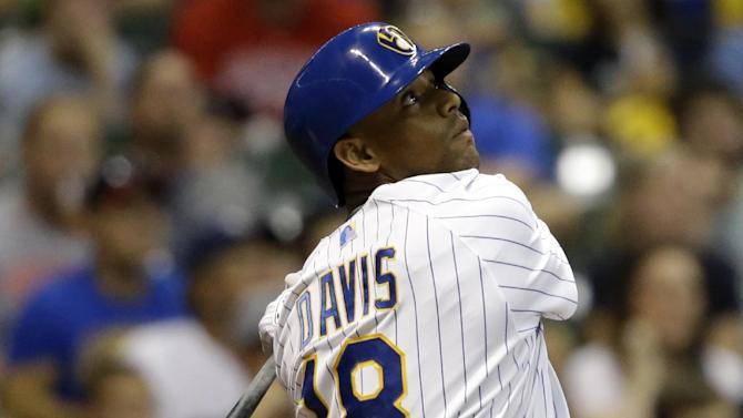 FILE - In this Aug. 14, 2015, file photo, Milwaukee Brewers' Khris Davis watches his home run against the Philadelphia Phillies during the second inning of a baseball game in Milwaukee. The Brewers have traded power-hitting outfielder Davis to the Oakland Athletics for a pair of prospects. (AP Photo/Jeffrey Phelps, File)