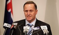 A man who threatened to kill New Zealand Prime Minister John Key by blowing him up as he dined in a restaurant was jailed Friday for 13 months, media reports said