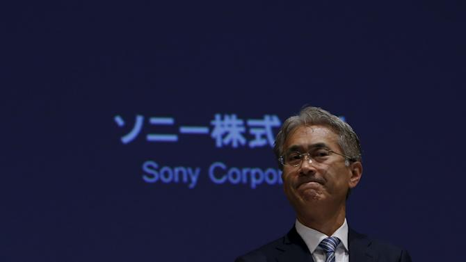 Sony Corp's Chief Financial Officer Yoshida leaves a news conference at the company's headquarters in Tokyo