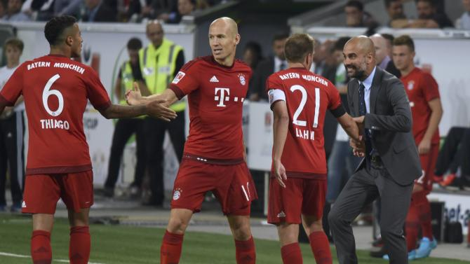 Bayern Munich's Robben celebrates after scoring goal against VfL Wolfsburg during German Supercup soccer match in Wolfsburg
