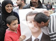 A Syrian kisses the portrait of President Bashar al-Assad during a rally to show their support in the capital Damascus on April 30. The Syrian authorities have set a deadline of 15 days for people who had committed &quot;unlawful acts&quot; to give themselves up, as a wave of arrests was reported across the country