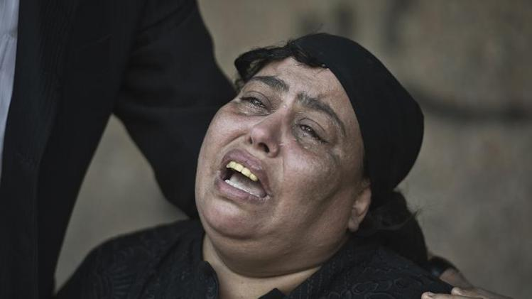 An Egyptian relative of a victim of a shooting spree targeting a wedding at a Cairo Coptic Church mourns at a morgue in the capital on October 21, 2013
