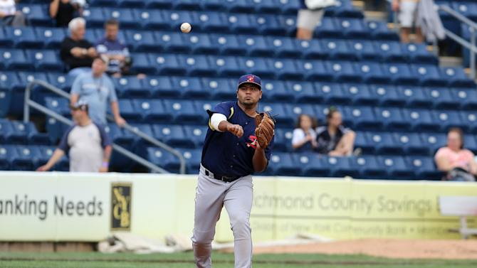 State College Spikes Ronnierd Garcia #40 warms up against the Staten Island Yankees during a minor league baseball game in Staten Island, NY on Sunday, June 28, 2015.  (AP Photo/Gregory Payan)