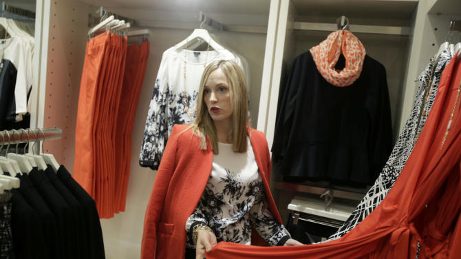 """In this Wednesday, Jan. 23, 2013 photo, creative director for Ann Taylor, Lisa Axelson discusses fashion at Ann Taylor's renovated location in The Westchester shopping mall in White Plains, N.Y. She pointed out the styles that she believes are the cornerstone of a woman's wardrobe in 2013. The store is set up like a closet, without a specific """"suits section"""" or all the denim tucked in the back corner.  (AP Photo/Seth Wenig)"""