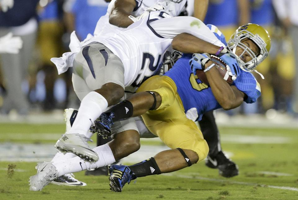 Brett Hundley leads No. 21 UCLA past Nevada, 58-20