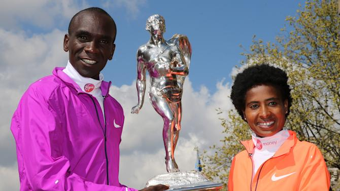 Athletics: Winners of the Virgin Money London Marathon, Kenya's Eliud Kipchoge and Ethiopia's Tigist Tufa pose with the winners trophy