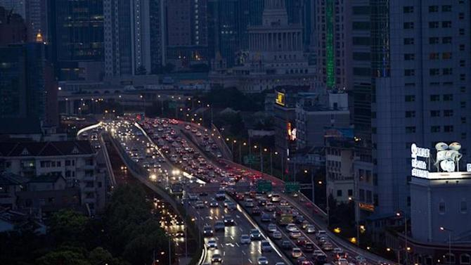 Lines of cars are pictured during a rush hour traffic jam in central Shanghai July 11, 2013. REUTERS/Aly Song/Files