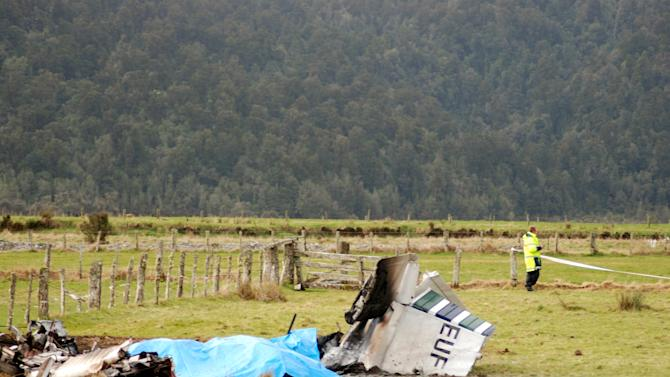FILE - In this Sept. 4, 2010 file photo, an investigator surveys the scene of a crash where nine people died including an Australian, a German, an Englishman and an Irishman when their aircraft carrying a group of skydivers crashed shortly after taking off from the air strip at Fox Glacier, New Zealand. (AP Photo/NZPA, Hokitika Guardian, File)