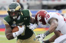 Colorado State running back Donnell Alexander (7) is hit by Washington State cornerback Nolan Washington (20) during the first half of the New Mexico Bowl NCAA college football game, Saturday, Dec. 21, 2013, in Albuquerque, N.M. (AP Photo/Matt York)