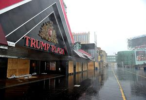 A boarded up Trump Plaza and an empty Boardwalk. | Photo Credits: Stan Honda/AFP/Getty Images