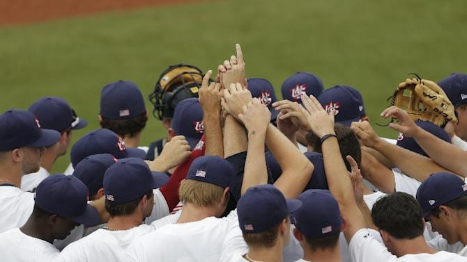 United States players come together prior to a baseball game against Cuba in Cary, N.C., Wednesday, July 1, 2015. (AP Photo/Gerry Broome)