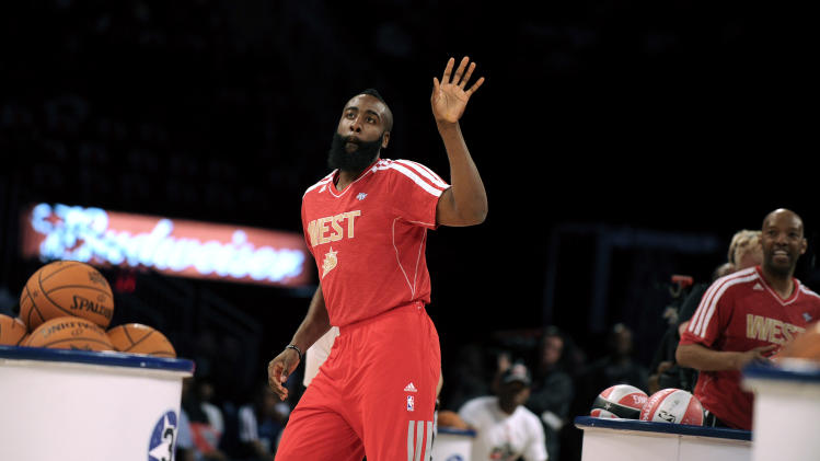 CORRECTS TO SHOOTING STARS CONTEST, NOT SKILLS CHALLENGE-  Houston Rockets' James Harden participates at the shooting stars contest during NBA All-Star Saturday Night basketball in Houston on Saturday, Feb. 16, 2013. (AP Photo/Pat Sullivan)