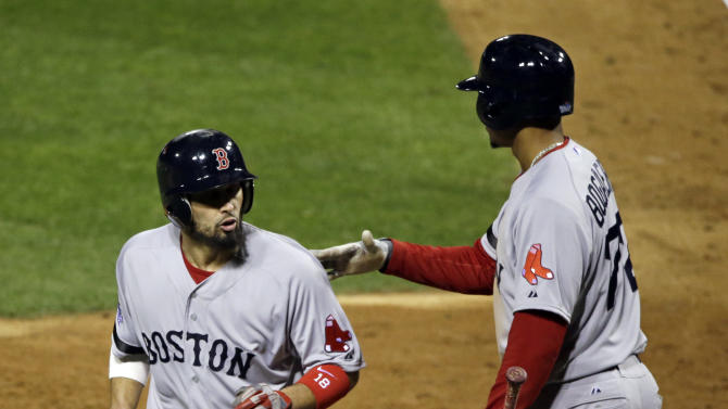 Boston Red Sox's Shane Victorino, left, is congratulated by Xander Bogaerts after scoring during the sixth inning of Game 3 of baseball's World Series against the St. Louis Cardinals Saturday, Oct. 26, 2013, in St. Louis. (AP Photo/Charlie Neibergall)