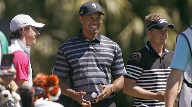 Tiger Woods (C) of the U.S. shares a laugh with his playing partners, Northern Ireland's Rory McIlroy (L) and Britain's Luke Donald on the 12th tee during first round play in the 2013 WGC-Cadillac Championship PGA golf tournament in Doral, Florida