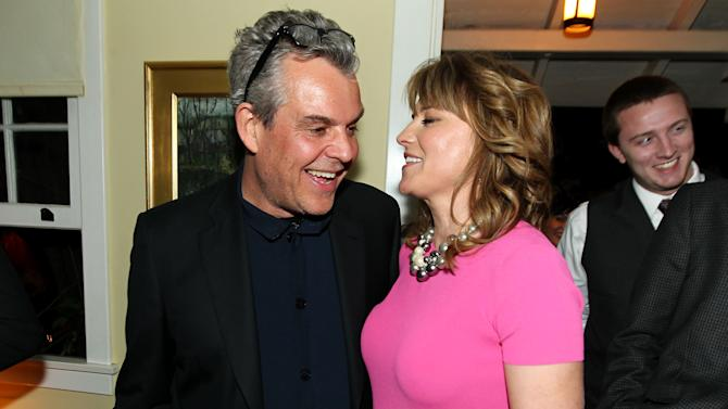 """Danny Huston, left, and Lucy Lawless pose together at the after party for the premiere of """"Spartacus: War of the Damned"""" on Tuesday, Jan. 22, 2013 in Los Angeles. """"Spartacus: War of the Damned"""" premieres Friday, Jan. 25 at 9PM on STARZ. (Photo by Matt Sayles/Invision for STARZ/AP Images)"""
