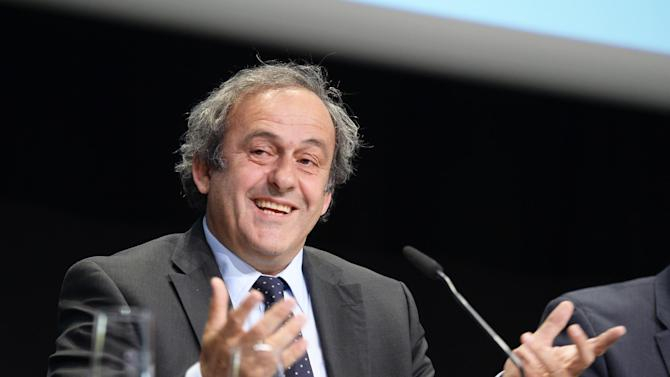"""FILE - In this May 28, 2015 file picture, UEFA-President Michel Platini speaks during a news  conference after a meeting of the European Soccer federation UEFA in Zurich, Switzerland. Michel Platini has launched his campaign to succeed Sepp Blatter as FIFA president, aiming to give the scandal-hit governing body """"the dignity and the position it deserves."""" Platini, the UEFA president and a FIFA vice president, wrote to member federations in Europe on Wednesday July 29, 2015 saying he will stand in the election and is counting on their support.  (Walter Bieri/Keystone via AP,file)"""
