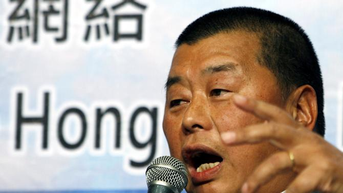 FILE - In this July 1, 2007 file photo, Hong Kong media tycoon Jimmy Lai, owner of the Hong Kong and Taiwan newspaper Apple Daily, speaks during a Democratic Party event in Hong Kong. Lai is selling major media holdings in Taiwan to a group headed by a local businessman whose family has substantial interests on the mainland. (AP Photo/Kin Cheung, File)