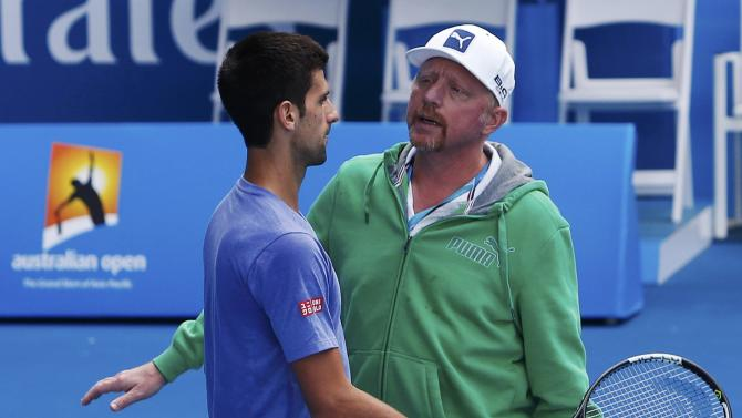Novak Djokovic of Serbia talks with his coach Boris Becker during a practice session at Margaret Court Arena in Melbourne