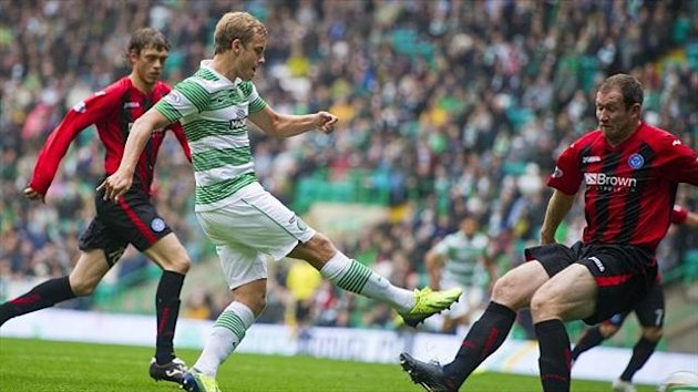 Teemu Pukki, centre, fires Celtic ahead at Celtic Park