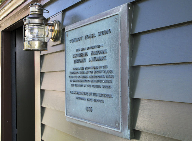A plaque on display Monday, Sept. 17, 2012, in Scarborough, Maine, shows that Winslow Homer's studio was designated a National Historic Landmark in 1966.The home where Homer lived and worked from 1883 until his death in 1910 is opening to the public following a multiyear, multimillion-dollar renovation by the Portland Museum of Art. Workers restored the exterior to its original colors, replaced the second-floor balcony, stabilized the foundation and replaced windows. The home will be open for public tours on Sept. 25. (AP Photo/Clarke Canfield)
