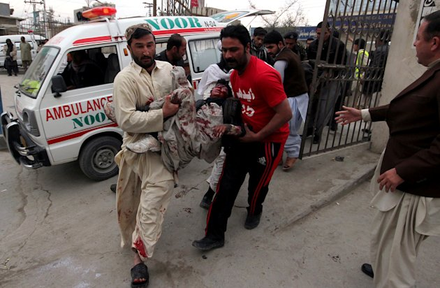 Pakistani volunteers rush an injured victim from a bomb blast to a local hospital for treatment in Quetta, Pakistan, Thursday, Jan. 10, 2013. A bomb targeting paramilitary soldiers killed scores of pe