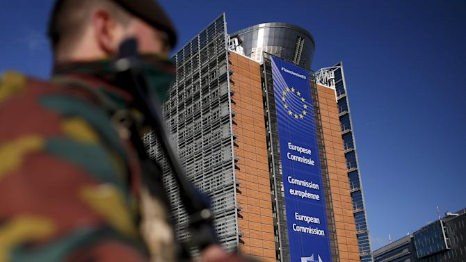 Belgian soldiers patrol outside the European Commission headquarters during a continued high level of security following the recent deadly Paris attacks