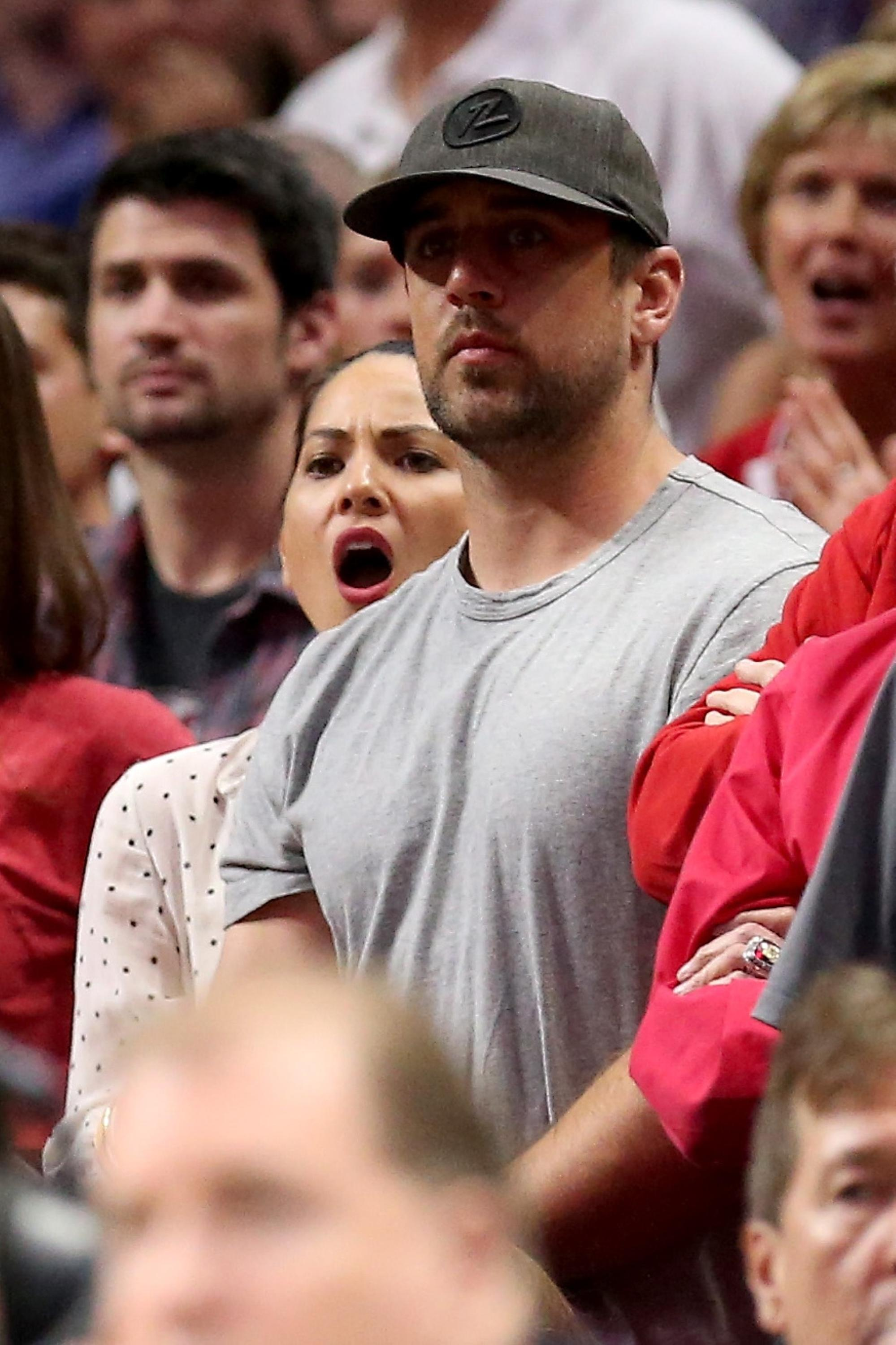 Aaron Rodgers and Olivia Munn celebrate Wisconsin's advance to Elite Eight