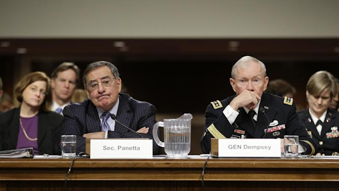 Outgoing Defense Secretary Leon Panetta, and  Joint Chiefs Chairman Gen. Martin Dempsey, testify on Capitol Hill in Washington, Thursday, Feb. 7, 2013, before the Senate Armed Services Committee about the Pentagon's role in responding to the attack last year on the U.S. consulate in Benghazi, Libya, where the ambassador and three other Americans were killed.  (AP Photo/J. Scott Applewhite)
